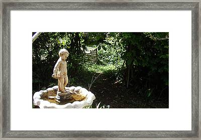 Cupid Of The Garden Framed Print by Edan Chapman