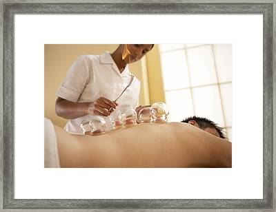 Cupping Framed Print