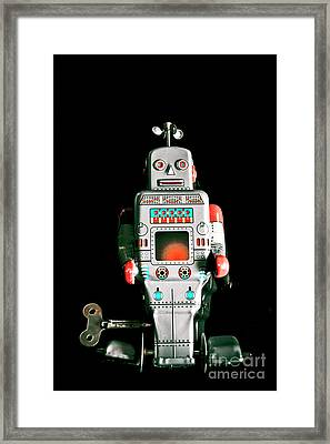 Cute 1970s Robot On Black Background Framed Print