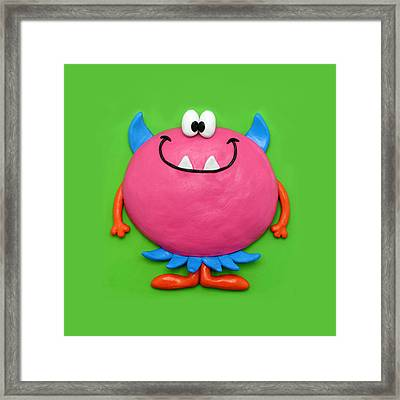 Cute Pink Monster Framed Print