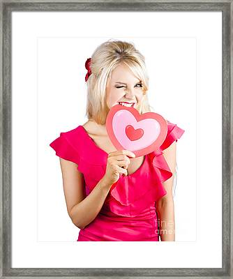 Cute Woman Biting Big Red Love Heart Framed Print