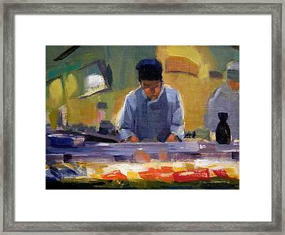 Cutting Sushi Framed Print by Merle Keller