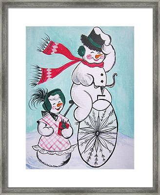 Cycling In The Snow Framed Print by Leslie Manley