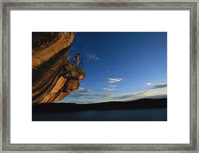 Cyclist Dan Davis Atop A Rock Overhang Framed Print by Bill Hatcher