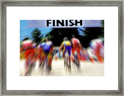 Cyclists Crossing The Finish Line Framed Print by Steve Ohlsen