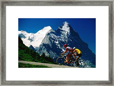 Cyclists In Front Of Eiger And Snow-covered Monch, Grosse Scheidegg, Grindelwald, Bern, Switzerland, Europe Framed Print by David Tomlinson