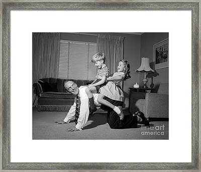 Dad Giving Children A Piggyback Ride Framed Print by Debrocke/ClassicStock