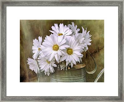 Framed Print featuring the photograph Daisies In Antique Watering Can by Bellesouth Studio