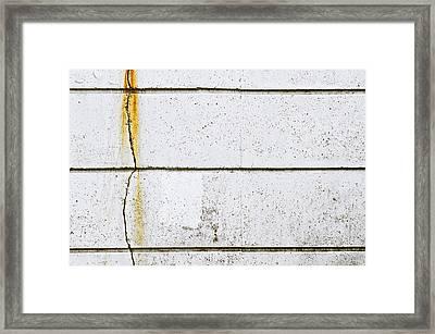 Damaged Stone Wall Framed Print by Tom Gowanlock