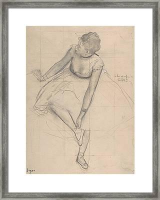 Dancer Adjusting Her Slipper Framed Print by Edgar Degas