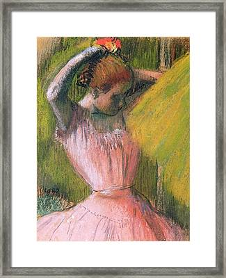 Dancer Arranging Her Hair Framed Print