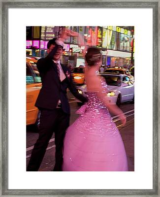 Dancing In Times Square Framed Print by Vijay Sharon Govender
