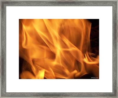 Framed Print featuring the photograph Dancing With Fire by Betty Northcutt