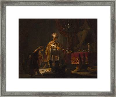 Daniel And Cyrus Before The Idol Bel Framed Print by Rembrandt