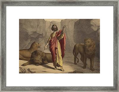 Daniel In The Lion's Den Framed Print by Jean-Baptiste Auguste Leloir