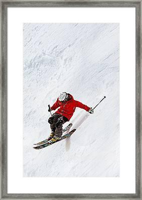 Daring Skier Flying Down A Steep Slope Framed Print
