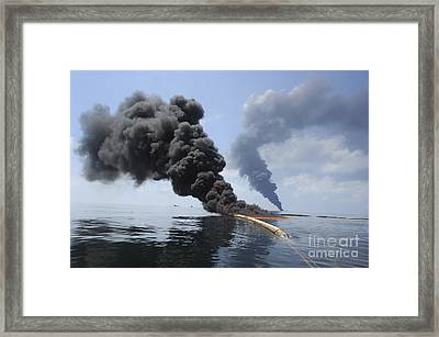 Dark Clouds Of Smoke And Fire Emerge Framed Print by Stocktrek Images