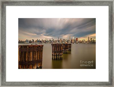Dark Clouds Over Nyc Framed Print by Abe Pacana