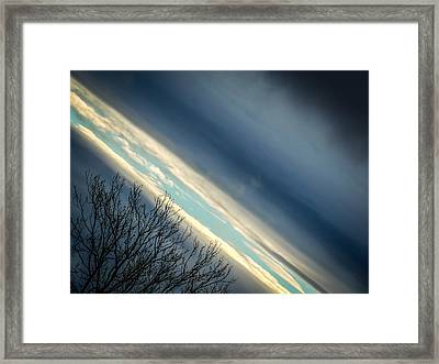 Dark Clouds Parting Framed Print