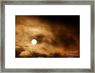 Dark Storm Clouds And Setting Sun Framed Print