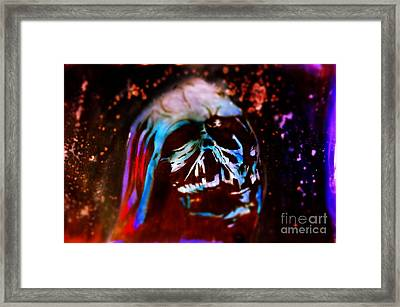 Darth Vader's Melted Helmet Framed Print