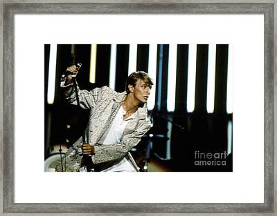 Framed Print featuring the photograph David Bowie Action Man by Sue Halstenberg