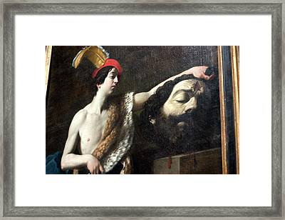 David Holds Goliath's Head Framed Print by Carl Purcell