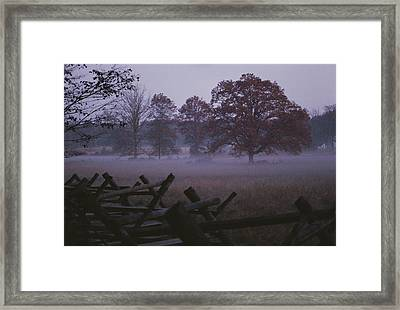 Dawn Mist Hangs Over A Field Bordered Framed Print by Stephen St. John