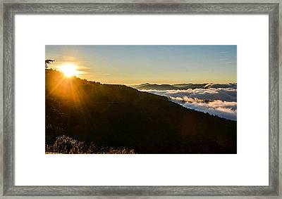 Daylight Above The Clouds Framed Print