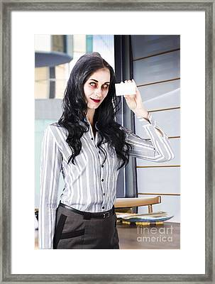 Dead Businessperson Holding Business Branding Card Framed Print by Jorgo Photography - Wall Art Gallery