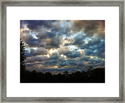 Deceptive Clouds Framed Print
