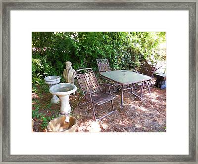 Decorative Furniture In A Garden 1 Framed Print by Lanjee Chee