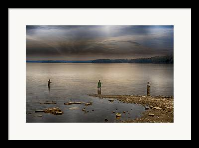Fishing During A Storm Framed Prints