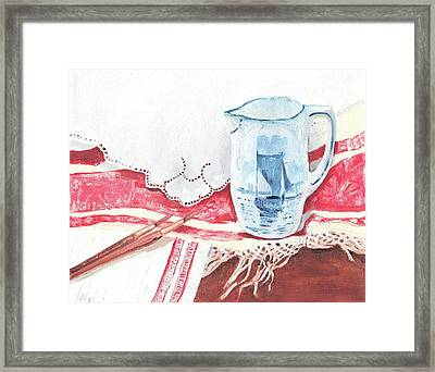 Delft And Linens Framed Print by Kathryn B