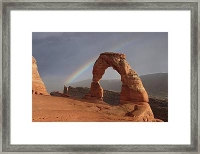 Framed Print featuring the photograph Delicate Arch And Rainbow by Marie Leslie