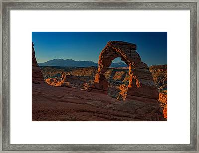 Delicate Arch At Sunrise Framed Print by Rick Berk