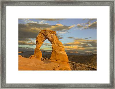 Delicate Arch At Sunset Framed Print by Adam Romanowicz
