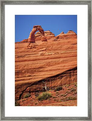 Delicate Arch From Afar Framed Print by Carolyn Derstine