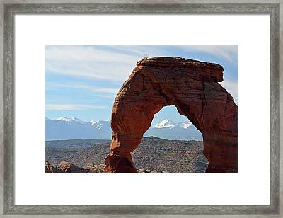 Framed Print featuring the photograph Delicate Arch With Wispy Clouds by Bruce Gourley