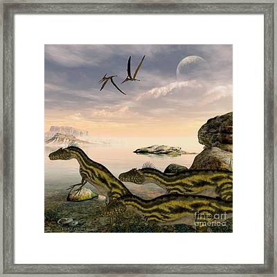 Deltadromeus Dinosaurs Framed Print by Corey Ford