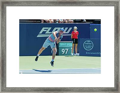 Dennis Uspensky Plays Center Court At The Winston-salem Open Framed Print by Bryan Pollard