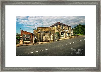 Derelict Old Garage Framed Print by Adrian Evans