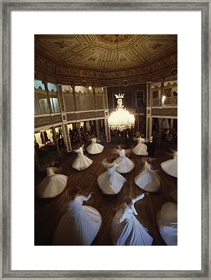 Dervishes Perform A Ritual Dance Framed Print
