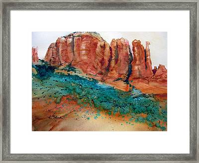 Desert Towers Framed Print by Karen Stark