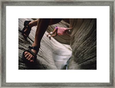 Detail Of Sandals And Hikers In A Slot Framed Print by Bobby Model