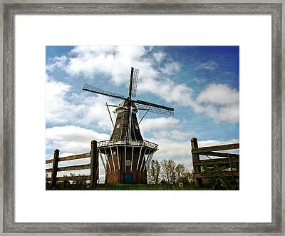 Framed Print featuring the photograph Dezwaan Windmill With Fence And Clouds by Michelle Calkins