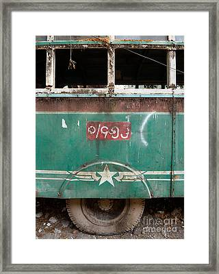 Dilapidated Vintage Green Bus In Burma - Side View With Tire Framed Print