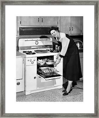 Dinner In The Oven Framed Print