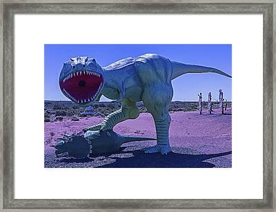 Dinosaur With Kill Framed Print by Garry Gay