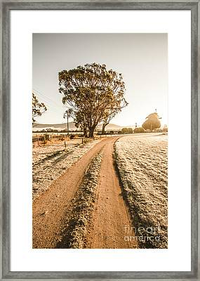 Dirt Frosted Country Road In Winter Framed Print by Jorgo Photography - Wall Art Gallery